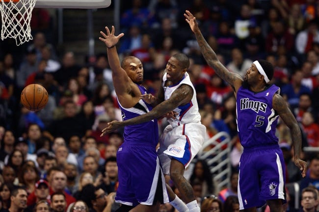 Nov 23, 2013; Los Angeles, CA, USA; Los Angeles Clippers guard Jamal Crawford (11) passes the ball defended by Sacramento Kings forward Chuck Hayes (42) during the second quarter at Staples Center. Mandatory Credit: Kelvin Kuo-USA TODAY Sports
