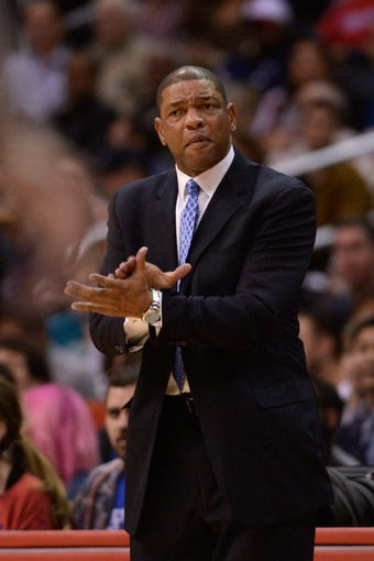 Nov 23, 2013; Los Angeles, CA, USA; Los Angeles Clippers head coach Doc Rivers reacts during the game against the Sacramento Kings during the second quarter at Staples Center. Mandatory Credit: Kelvin Kuo-USA TODAY Sports