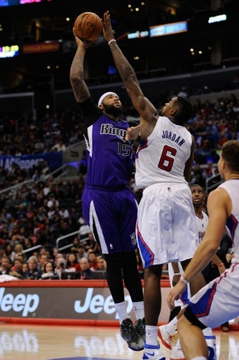 Nov 23, 2013; Los Angeles, CA, USA; Sacramento Kings center DeMarcus Cousins (15) goes up for a shot defended by Los Angeles Clippers center DeAndre Jordan (6) during the second quarter at Staples Center. Mandatory Credit: Kelvin Kuo-USA TODAY Sports