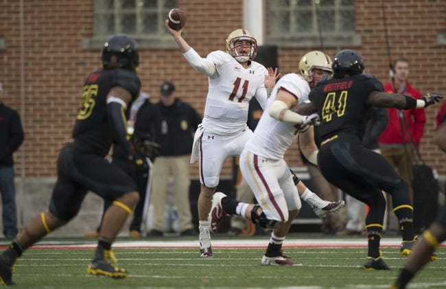 Nov 23, 2013; College Park, MD, USA; Boston College Eagles quarterback Chase Rettig (11) throws the ball  during the first half against the Maryland Terrapins at Byrd Stadium. Mandatory Credit: Tommy Gilligan-USA TODAY Sports