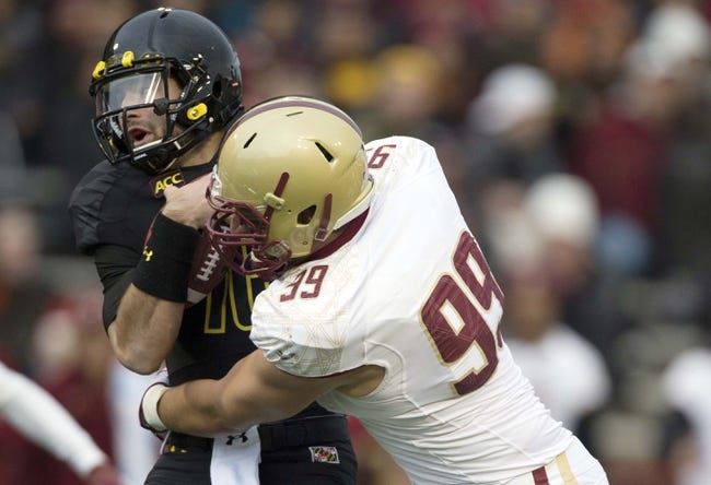 Nov 23, 2013; College Park, MD, USA;  Boston College  Eagles defensive lineman Brian Mihalik (99) sacks Maryland Terrapins quarterback C.J. Brown (16) during the first half at Byrd Stadium. Mandatory Credit: Tommy Gilligan-USA TODAY Sports