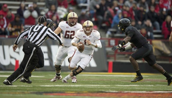 Nov 23, 2013; College Park, MD, USA;  Boston College Eagles quarterback Chase Rettig (11) scrambles with the ball during the first half of the game against the Maryland Terrapins at Byrd Stadium. Mandatory Credit: Tommy Gilligan-USA TODAY Sports