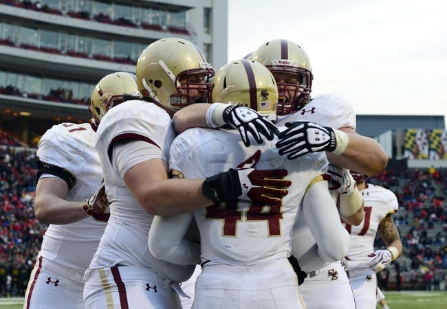 Nov 23, 2013; College Park, MD, USA;  Boston College Eagles running back Andre Williams (44) celebrates with his teammates after scoring a touchdown during the first half of the game against the Maryland Terrapins at Byrd Stadium. Mandatory Credit: Tommy Gilligan-USA TODAY Sports