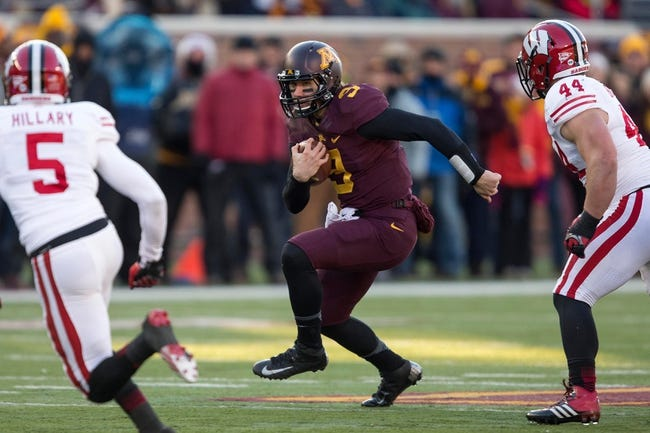 Nov 23, 2013; Minneapolis, MN, USA; Minnesota Golden Gophers quarterback Philip Nelson (9) rushes with the ball in the second quarter against the Wisconsin Badgers at TCF Bank Stadium. Mandatory Credit: Jesse Johnson-USA TODAY Sports