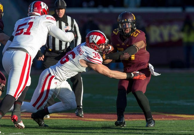 Nov 23, 2013; Minneapolis, MN, USA; Minnesota Golden Gophers running back David Cobb (27) gets tackled by Wisconsin Badgers linebacker Ethan Armstrong (36) after rushing for a first down in the second quarter at TCF Bank Stadium. Mandatory Credit: Jesse Johnson-USA TODAY Sports