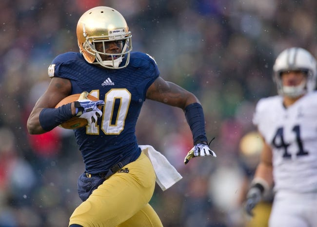 Nov 23, 2013; South Bend, IN, USA; Notre Dame Fighting Irish wide receiver DaVaris Daniels (10) runs for a touchdown in the first quarter against the BYU Cougars at Notre Dame Stadium. Mandatory Credit: Matt Cashore-USA TODAY Sports
