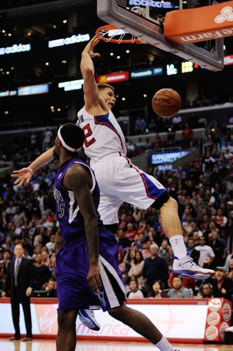 Nov 23, 2013; Los Angeles, CA, USA; Los Angeles Clippers forward Blake Griffin (32) dunks the ball defended by Sacramento Kings forward John Salmons (5) during the fourth quarter at Staples Center. The Los Angeles Clippers defeated the Sacramento Kings 103-102. Mandatory Credit: Kelvin Kuo-USA TODAY Sports
