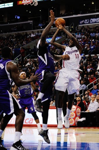 Nov 23, 2013; Los Angeles, CA, USA; Los Angeles Clippers guard Jamal Crawford (11) goes up for a shot defended by Sacramento Kings center DeMarcus Cousins (15) during the fourth quarter at Staples Center. The Los Angeles Clippers defeated the Sacramento Kings 103-102. Mandatory Credit: Kelvin Kuo-USA TODAY Sports