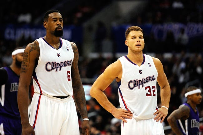 Nov 23, 2013; Los Angeles, CA, USA; Los Angeles Clippers forward Blake Griffin (32) and Los Angeles Clippers center DeAndre Jordan (6) stand during a break in play against the Sacramento Kings during the fourth quarter at Staples Center. The Los Angeles Clippers defeated the Sacramento Kings 103-102. Mandatory Credit: Kelvin Kuo-USA TODAY Sports