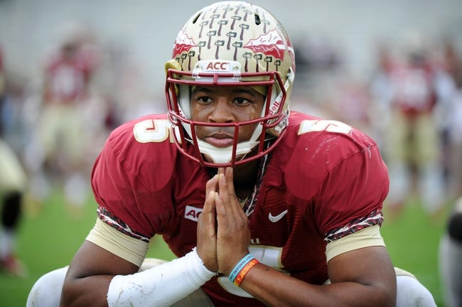 Nov 23, 2013; Tallahassee, FL, USA; Florida State Seminoles quarterback Jameis Winston (5) warms up before the game against the Idaho Vandals at Doak Campbell Stadium. Mandatory Credit: Melina Vastola-USA TODAY Sports