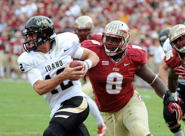 Nov 23, 2013; Tallahassee, FL, USA; Florida State Seminoles defensive tackle Timmy Jernigan (8) pressures Idaho Vandals quarterback Taylor Davis (12)   during the first half at Doak Campbell Stadium. Mandatory Credit: Melina Vastola-USA TODAY Sports