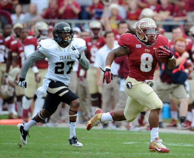Nov 23, 2013; Tallahassee, FL, USA; Florida State Seminoles running back Devonta Freeman (8) runs for a touchdown past Idaho Vandals cornerback Delency Parham (27) during the first half at Doak Campbell Stadium. Mandatory Credit: Melina Vastola-USA TODAY Sports
