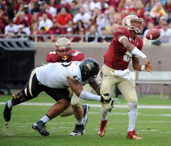 Nov 23, 2013; Tallahassee, FL, USA; Florida State Seminoles quarterback Jameis Winston (5) has the ball stripped away by Idaho Vandals defensive tackle QuayShawne Buckley (57) during the first half at Doak Campbell Stadium. Mandatory Credit: Melina Vastola-USA TODAY Sports
