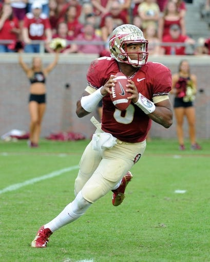 Nov 23, 2013; Tallahassee, FL, USA; Florida State Seminoles quarterback Jameis Winston (5) looks to throw the ball during the first half against the Idaho Vandals at Doak Campbell Stadium. Mandatory Credit: Melina Vastola-USA TODAY Sports