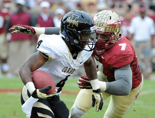 Nov 23, 2013; Tallahassee, FL, USA; Idaho Vandals running back Richard Montgomery (4) is tackled by Florida State Seminoles linebacker Christian Jones (7) during the first half at Doak Campbell Stadium. Mandatory Credit: Melina Vastola-USA TODAY Sports