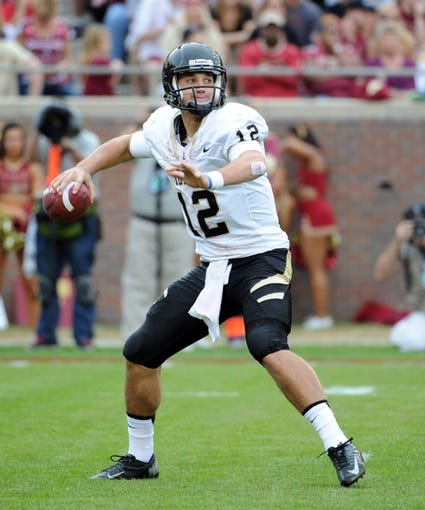 Nov 23, 2013; Tallahassee, FL, USA; Idaho Vandals quarterback Taylor Davis (12) looks to throw the ball during the first half against the Florida State Seminoles at Doak Campbell Stadium. Mandatory Credit: Melina Vastola-USA TODAY Sports