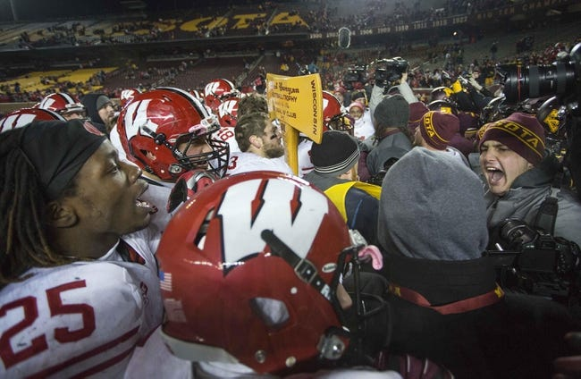 Nov 23, 2013; Minneapolis, MN, USA; A fight breaks out between the Wisconsin Badgers and Minnesota Golden Gophers after the game at TCF Bank Stadium. The Badgers won 20-7. Mandatory Credit: Jesse Johnson-USA TODAY Sports