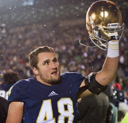Nov 23, 2013; South Bend, IN, USA; Notre Dame Fighting Irish linebacker Dan Fox (48) salutes the crowd after Notre Dame defeated the BYU Cougars 23-13 at Notre Dame Stadium. Mandatory Credit: Matt Cashore-USA TODAY Sports