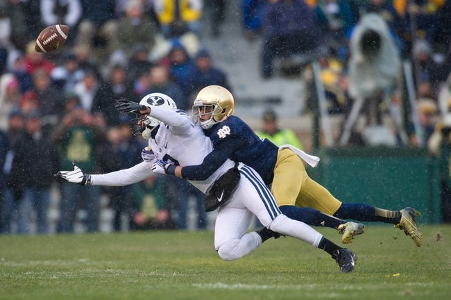 Nov 23, 2013; South Bend, IN, USA; BYU Cougars wide receiver Cody Hoffman (2) attempts to catch a pass as Notre Dame Fighting Irish cornerback Bennett Jackson (2) defends in the first quarter at Notre Dame Stadium. Notre Dame won 23-13. Mandatory Credit: Matt Cashore-USA TODAY Sports