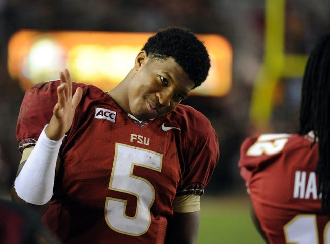 Nov 23, 2013; Tallahassee, FL, USA; Florida State Seminoles quarterback Jameis Winston (5) congratulates teammates after the game against the Idaho Vandals at Doak Campbell Stadium. Mandatory Credit: Melina Vastola-USA TODAY Sports
