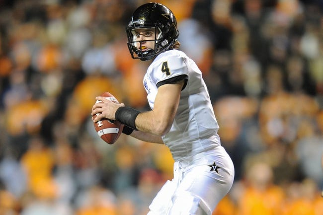 Nov 23, 2013; Knoxville, TN, USA; Vanderbilt Commodores quarterback Patton Robinette (4) looks to pass the ball against the Tennessee Volunteers during the first quarter against the Tennessee Volunteers at Neyland Stadium. Mandatory Credit: Randy Sartin-USA TODAY Sports