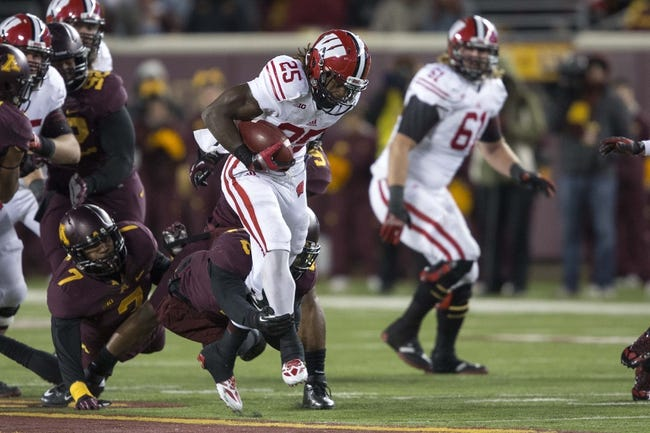Nov 23, 2013; Minneapolis, MN, USA; Wisconsin Badgers running back Melvin Gordon (25) rushes for a first down in the second half against the Minnesota Golden Gophers at TCF Bank Stadium. The Badgers won 20-7. Mandatory Credit: Jesse Johnson-USA TODAY Sports