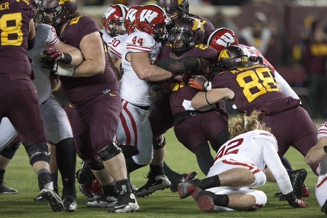 Nov 23, 2013; Minneapolis, MN, USA; Minnesota Golden Gophers running back David Cobb (27) gets tackled at the line of scrimmage by Wisconsin Badgers linebacker Chris Borland (44) in the second half at TCF Bank Stadium. The Badgers won 20-7. Mandatory Credit: Jesse Johnson-USA TODAY Sports