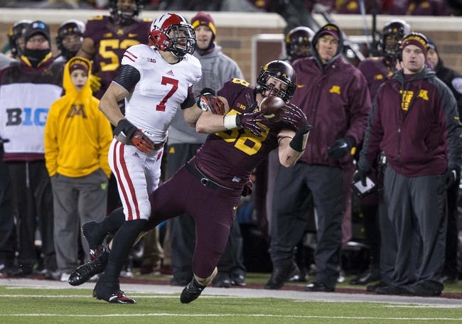 Nov 23, 2013; Minneapolis, MN, USA; Minnesota Golden Gophers tight end Maxx Williams (88) catches a pass over Wisconsin Badgers safety Michael Caputo (7) in the second half at TCF Bank Stadium. The Badgers won 20-7. Mandatory Credit: Jesse Johnson-USA TODAY Sports