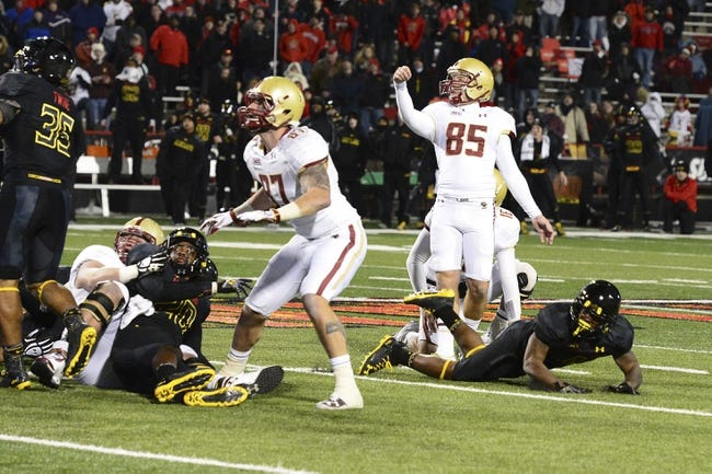 Nov 23, 2013; College Park, MD, USA;  Boston College Eagles kicker Nate Freese (85) watches his  52 yard field goal attempt go through the uprights as time expires to win the game against the Maryland Terrapins at Byrd Stadium. Boston College Eagles defeated Maryland Terrapins 29-26. Mandatory Credit: Tommy Gilligan-USA TODAY Sports