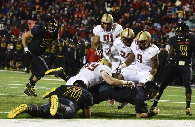 Nov 23, 2013; College Park, MD, USA;  Maryland Terrapins quarterback C.J. Brown (16) dives in for a touchdown during the fourth quarter against the Boston College Eagles at Byrd Stadium. Boston College Eagles defeated Maryland Terrapins 29-26. Mandatory Credit: Tommy Gilligan-USA TODAY Sports