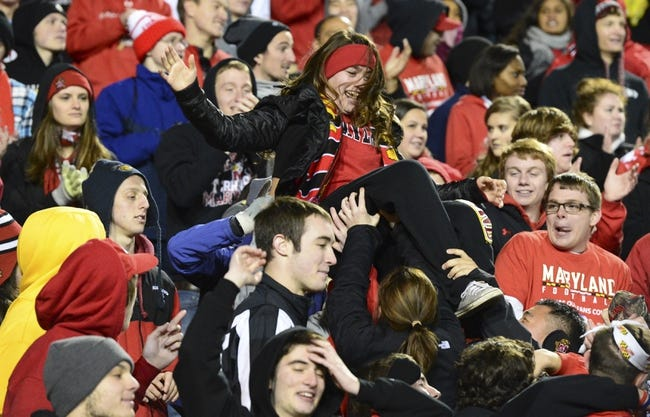 Nov 23, 2013; College Park, MD, USA;  Maryland Terrapin students celebrate after Maryland Terrapins quarterback C.J. Brown (16) touchdown during the fourth quarter of the game against the Boston College Eagles at Byrd Stadium. Boston College Eagles defeated Maryland Terrapins 29-26. Mandatory Credit: Tommy Gilligan-USA TODAY Sports