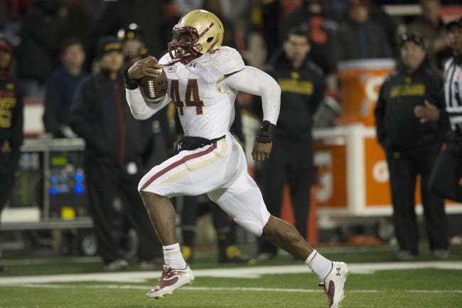 Nov 23, 2013; College Park, MD, USA; Boston College Eagles running back Andre Williams (44) runs with the ball for a touchdown during the second half od the game against the Maryland Terrapins at Byrd Stadium. Boston College Eagles defeated Maryland Terrapins 29-26. Mandatory Credit: Tommy Gilligan-USA TODAY Sports