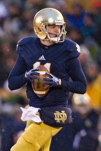 Nov 23, 2013; South Bend, IN, USA; Notre Dame Fighting Irish quarterback Tommy Rees (11) looks to throw in the second quarter against the BYU Cougars at Notre Dame Stadium. Notre Dame won 23-13. Mandatory Credit: Matt Cashore-USA TODAY Sports
