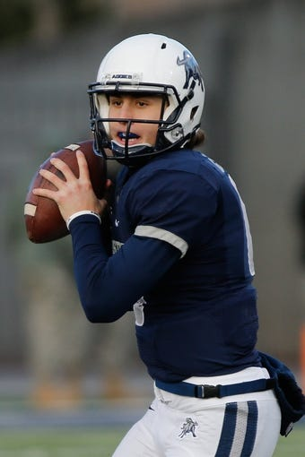 Nov 23, 2013; Logan, UT, USA; Utah State Aggies quarterback Darell Garretson (6) looks to pass down the field against the Colorado State Rams in the third quarter at Romney Stadium. Utah State Aggies won 13-0. Mandatory Credit: Chris Nicoll-USA TODAY Sports