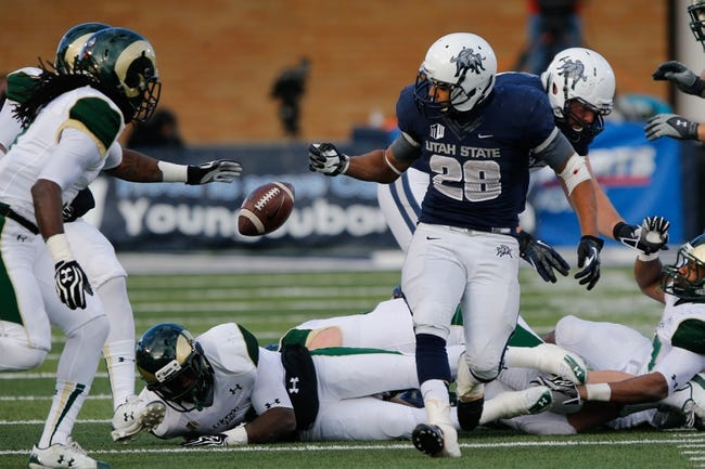 Nov 23, 2013; Logan, UT, USA; Utah State Aggies running back Joey DeMartino (28) fumbles the football during the third quarter.  Utah State Aggies would recover the ball at Romney Stadium. Utah State Aggies won 13-0. Mandatory Credit: Chris Nicoll-USA TODAY Sports