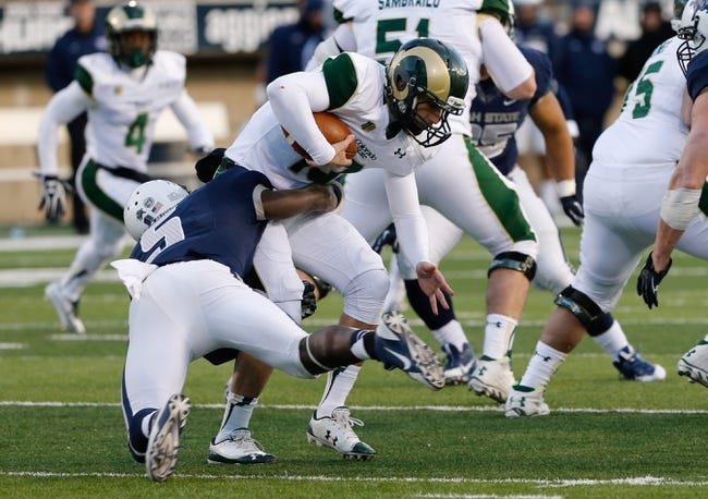 Nov 23, 2013; Logan, UT, USA; Colorado State Rams quarterback Garrett Grayson (18) is sacked by Utah State Aggies safety Maurice Alexander (5) during the fourth quarter at Romney Stadium. Utah State Aggies won 13-0. Mandatory Credit: Chris Nicoll-USA TODAY Sports