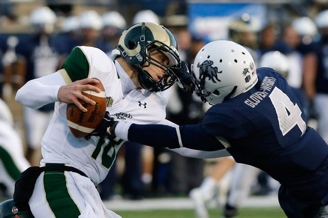 Nov 23, 2013; Logan, UT, USA; While Colorado State Rams quarterback Garrett Grayson (18) scrambles, Utah State Aggies cornerback Tay Glover-Wright (4) grabs ahold of his face mask during the fourth quarter at Romney Stadium. Utah State Aggies won 13-0. Mandatory Credit: Chris Nicoll-USA TODAY Sports