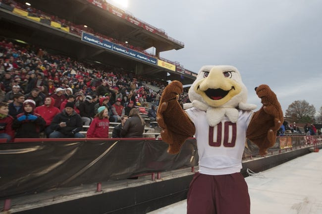 Nov 23, 2013; College Park, MD, USA;  Boston College Eagles mascot cheers during the first half of the game against the Maryland Terrapins at Byrd Stadium. Boston College Eagles defeated Maryland Terrapins 29-26. Mandatory Credit: Tommy Gilligan-USA TODAY Sports