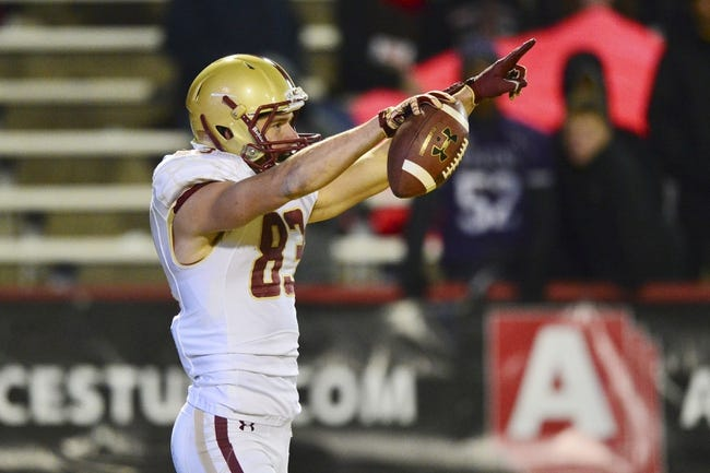 Nov 23, 2013; College Park, MD, USA; Boston College Eagles wide receiver Alex Amidon (83) points to his team after scoring a touchdown  during the forth quarter of the game against the Maryland Terrapins at Byrd Stadium. Boston College Eagles defeated Maryland Terrapins 29-26. Mandatory Credit: Tommy Gilligan-USA TODAY Sports