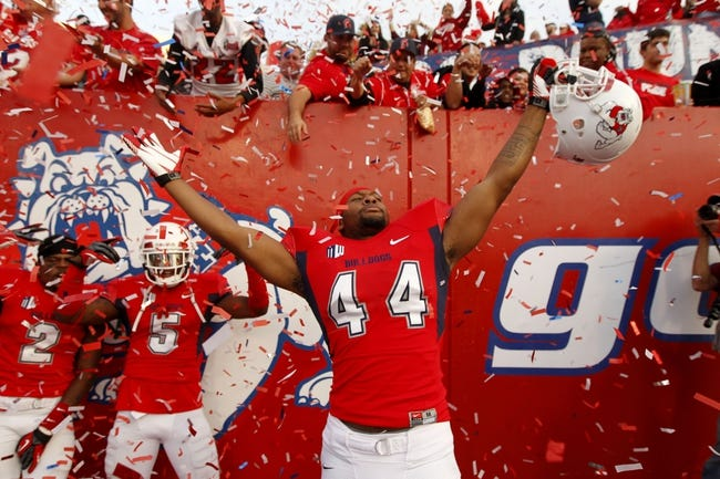 Nov 23, 2013; Fresno, CA, USA; Fresno State Bulldogs linebacker Jaamal Rose (44) celebrates after the Bulldogs defeated the New Mexico Lobos to win the West Division of the Mountain West Conference at Bulldog Stadium. The Bulldogs defeated the Lobos 69-28. Mandatory Credit: Cary Edmondson-USA TODAY Sports
