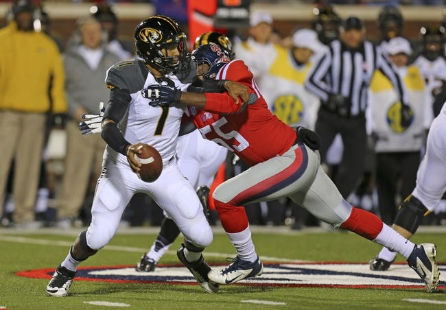 Nov 23, 2013; Oxford, MS, USA; Missouri Tigers quarterback Maty Mauk (7) struggles to break free from Mississippi Rebels defensive end Cameron Whigham (55) during the game at Vaught-Hemingway Stadium. Mandatory Credit: Spruce Derden-USA TODAY Sports