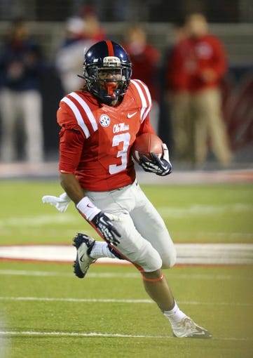 Nov 23, 2013; Oxford, MS, USA; Mississippi Rebels running back Jeff Scott (3) advances the ball during the game against the Missouri Tigers at Vaught-Hemingway Stadium. Mandatory Credit: Spruce Derden-USA TODAY Sports