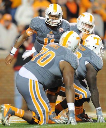 Nov 23, 2013; Knoxville, TN, USA; Tennessee Volunteers quarterback Joshua Dobbs (11) during the second quarter against the Vanderbilt Commodores at Neyland Stadium. Mandatory Credit: Randy Sartin-USA TODAY Sports
