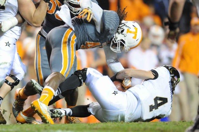 Nov 23, 2013; Knoxville, TN, USA; Tennessee Volunteers linebacker A.J. Johnson (45) tackles Vanderbilt Commodores quarterback Patton Robinette (4) during the second quarter at Neyland Stadium. Mandatory Credit: Randy Sartin-USA TODAY Sports