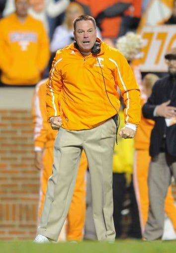 Nov 23, 2013; Knoxville, TN, USA; Tennessee Volunteers head coach Butch Jones disagrees with an officials call during the second quarter against the Vanderbilt Commodores at Neyland Stadium. Mandatory Credit: Randy Sartin-USA TODAY Sports