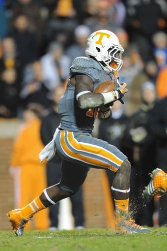 Nov 23, 2013; Knoxville, TN, USA; Tennessee Volunteers running back Marlin Lane (15) runs the ball against the Vanderbilt Commodores during the second quarter at Neyland Stadium. Mandatory Credit: Randy Sartin-USA TODAY Sports