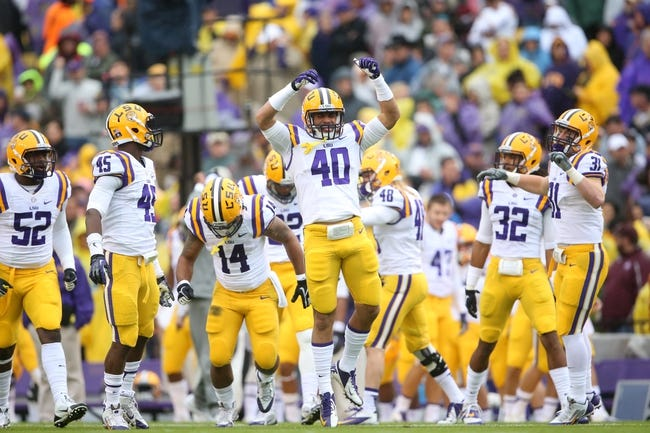 Nov 23, 2013; Baton Rouge, LA, USA; LSU Tigers linebacker Duke Riley (40) and teammates raise their arms to the crowd and dance prior to kickoff against the Texas A&M Aggies at Tiger Stadium. LSU defeated Texas A&M 34-10. Mandatory Credit: Crystal LoGiudice-USA TODAY Sports