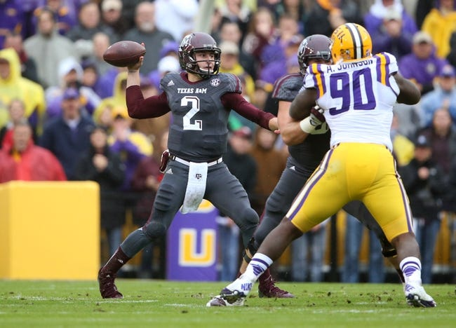 Nov 23, 2013; Baton Rouge, LA, USA; Texas A&M Aggies quarterback Johnny Manziel (2) passes the ball against the LSU Tigers in the first half at Tiger Stadium. LSU defeated Texas A&M 34-10. Mandatory Credit: Crystal LoGiudice-USA TODAY Sports