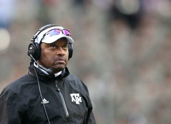 Nov 23, 2013; Baton Rouge, LA, USA; Texas A&M Aggies head coach Kevin Sumlin watches from the sideline in the first half against the LSU Tigers at Tiger Stadium. LSU defeated Texas A&M 34-10. Mandatory Credit: Crystal LoGiudice-USA TODAY Sports