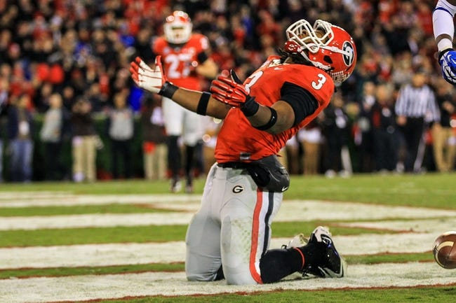 Nov 23, 2013; Athens, GA, USA; Georgia Bulldogs running back Todd Gurley (3) celebrates a touchdown in the first half against the Kentucky Wildcats at Sanford Stadium. Mandatory Credit: Daniel Shirey-USA TODAY Sports